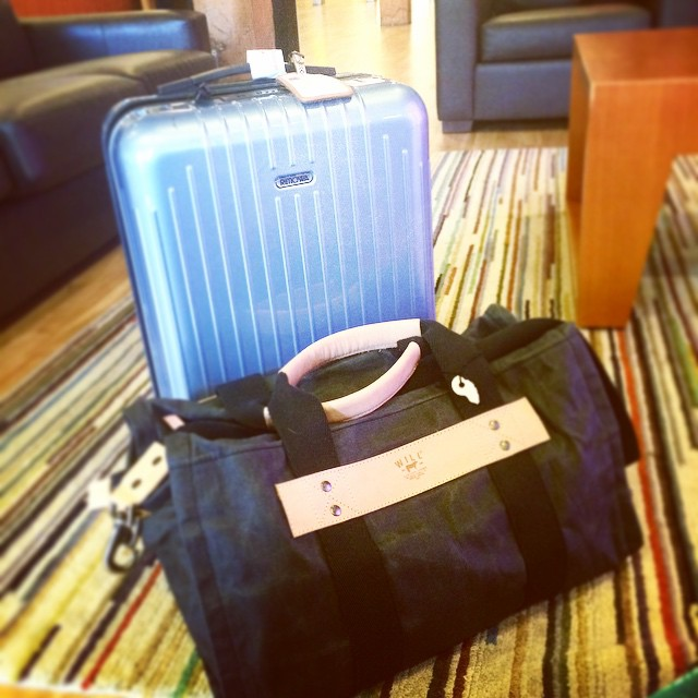 That's how I roll, literally. Rimowa salsa air carry on and a Will Leather wax canvas bag. These two things work really well together, especially for long overseas trips.